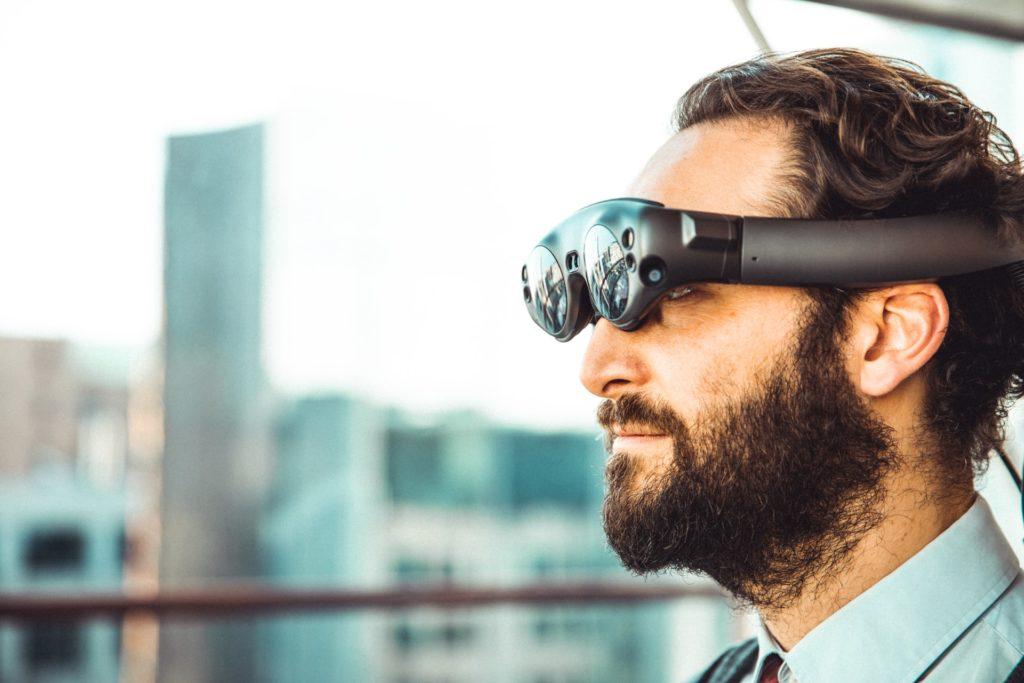 bearded man wearing mixed reality glasses
